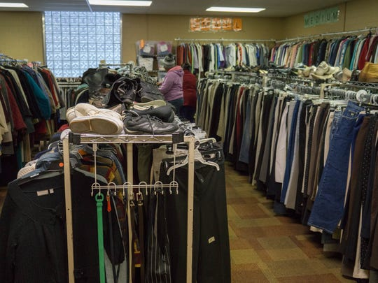Patrons shop for winter clothes at the Charitable Union.