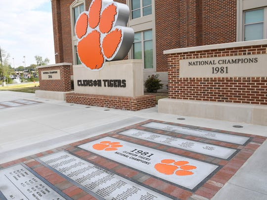 A recently added monument with engraved names of players from both 1981 and 2016 National Championship teams outside the Allen Reeves football complex, before the annual Spring football game at Memorial Stadium in Clemson on Saturday, April 14, 2018.