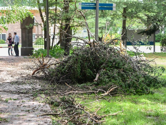 A pile of debris is ready to be removed Tuesday, June