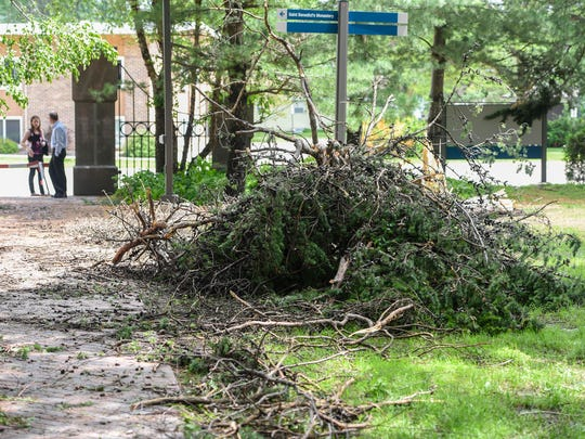 A pile of debris is ready to be removed Tuesday, June 12, from an area damaged by high winds Monday evening on the campus of the College of St. Benedict in St. Joseph.