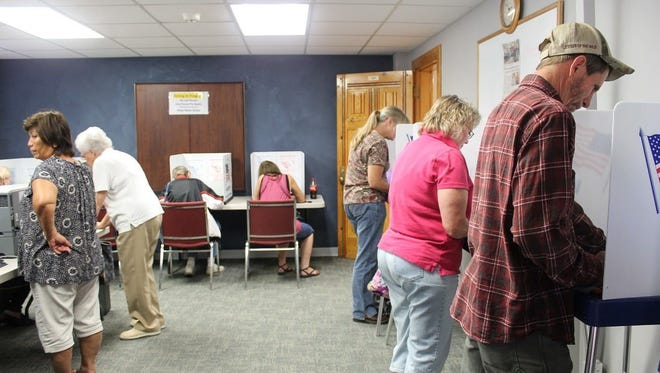 In this file photo, Otero County residents cast their ballot during early voting at the Otero County Administration Building.
