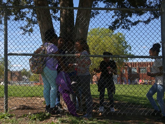 A group of children play outside of Moulton Elementary