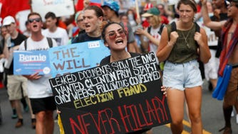 Supporters of Sen. Bernie Sanders march during a protest in downtown Philadelphia on the first day of the Democratic National Convention. (AP Photo/John Minchillo)