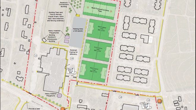 A concept plan for Johnson Elementary and Freedom Intermediate School shows additional sidewalks and sports fields.