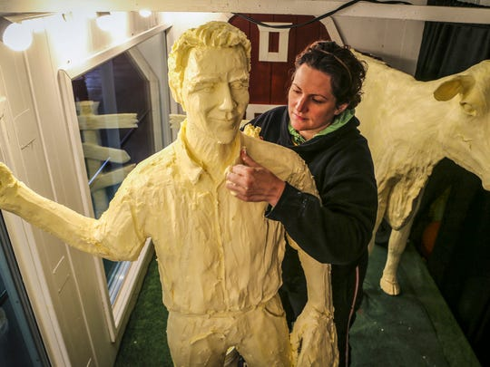 "2014 Iowa State Fair butter sculptress Sarah Pratt works on her butter rendition of Kevin Costner in a scene from the movie ""Field of Dreams"" for this year's fair."