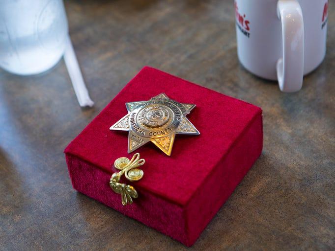Gene Adballah's deputy sheriff badge is shown at Marlin's