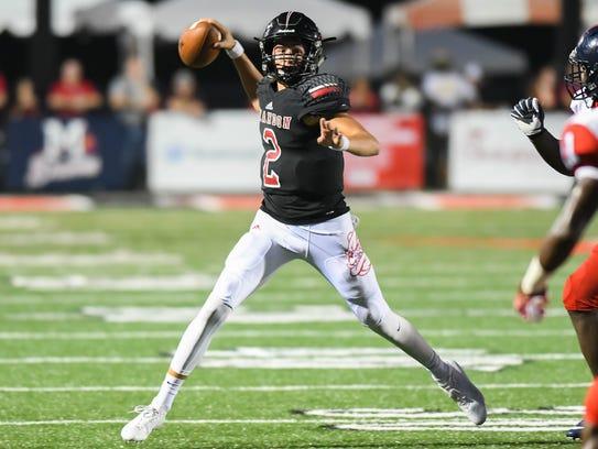Brandon High School quarterback Will Rogers (2) throws