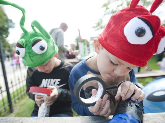Young patrons make space guns at Sputnikfest at Rahr-West Art Museum in 2015.