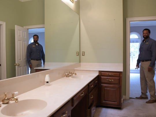 The master bath suite has a double-sink vanity, separate