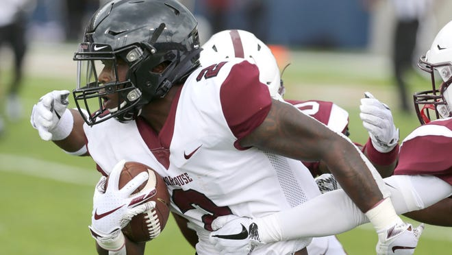 Morehouse's Frank Bailey Jr. picks up yardage during the first quarter of the Black College Football Hall of Fame Classic against Alabama A&M at Tom Benson Hall of Fame Stadium in Canton on Sunday, Sept. 1, 2019.