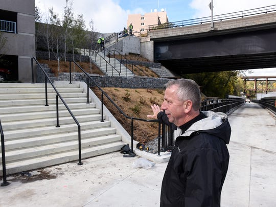 Mayor Dave Kleis points to features of  a new area of downtown extension of the Beaver Islands Trail near the River's Edge Convention Center Friday, Sept. 7, in St. Cloud.
