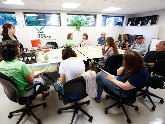 Nyack residents attend a lecture on seed collection led by Jennifer Guinta-Hausler, co-founder of the Nyack Seed Exchange at the Nyack Public Library on Saturday, September 23, 2017.