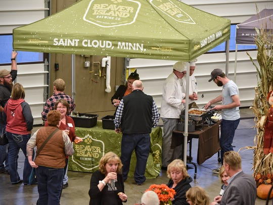 People line up to sample craft beer and hotdish during