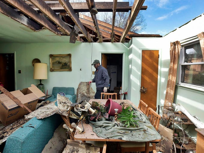 Nick Sims surveys the damage to his grandmother's house