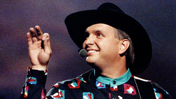 Garth Brooks waves to fans in the Grand Ole Orpy House