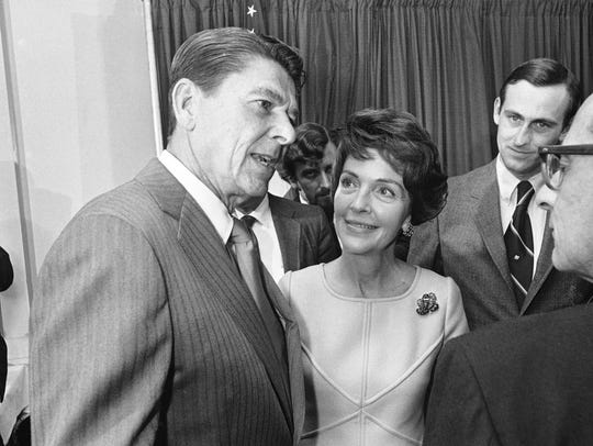 The Reagans speak to attendees at a news conference