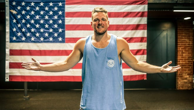 Former Colts punter Pat McAfee stands in front of a large American flag hanging in the headquarters for his newest business venture, Barstool Heartland on Tuesday, August 23, 2017.