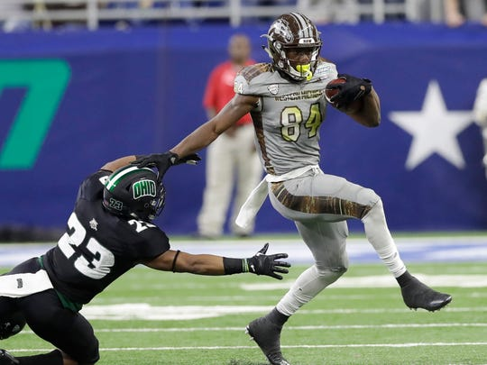 Western Michigan wide receiver Corey Davis (84) pulls away from Ohio safety Kylan Nelson during the first half of the Mid-American Conference championship NCAA college football game, Friday, Dec. 2, 2016, in Detroit.