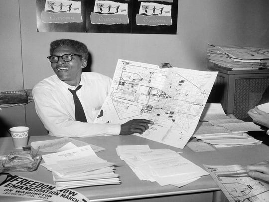 Bayard Rustin, deputy director of the planned march on Washington program, points to a map showing the line of march during a New York news conference on Aug. 24, 1963.