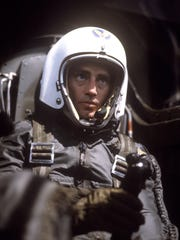 Sam Shepard as Chuck Yeager, seated in cockpit.