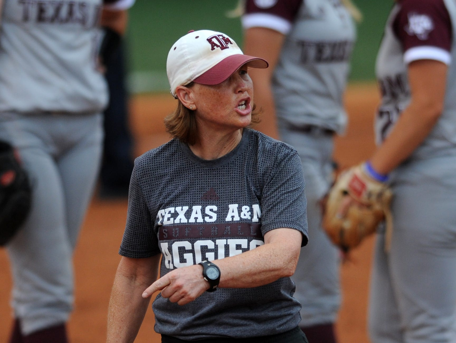 Texas A&M's head coach Jo Evans walks onto the field to dispute a call during a NCAA Super Regional game between Tennessee and Texas A&M at Sherri Parker Lee Stadium on Saturday, May 27, 2017. Texas A&M defeated Tennessee 6-5.