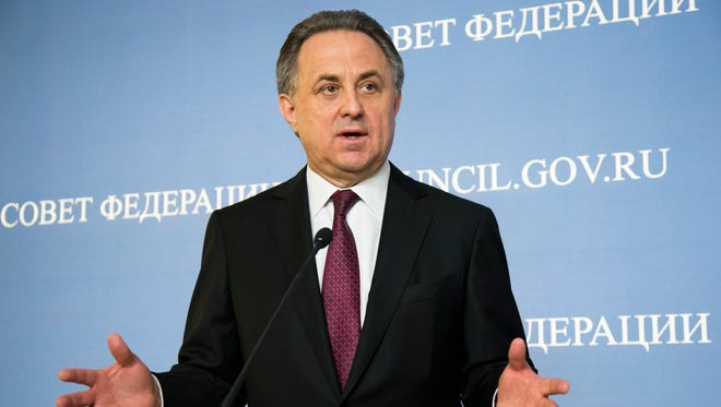 FILE - In this file photo taken on Wednesday, April  20, 2016, Russia's Sports Minister Vitaly Mutko gestures while speaking during a news conference after he addressed the upper chamber of the Russian parliament in Moscow.