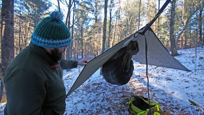 Nick Gordon shows off his hammock setup for winter camping at the Frozen Butt Hang outside Waupaca on Jan. 13, 2018.