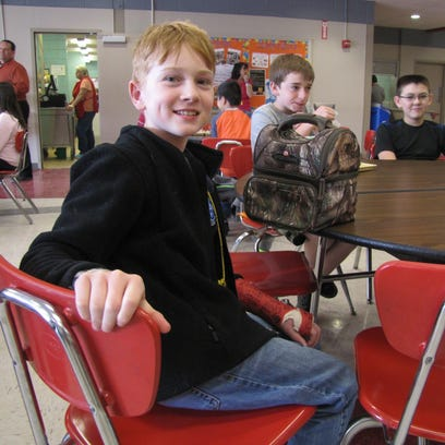 Candon Westervelt, 11, of Lockwood, sits at lunch with
