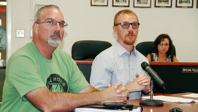 Foxhole Homes founding members Darron Williams and Ted Brinegar present to county commissioners a proposal to research a test site to develop affordable housing for veterans in need at Thursday's county commission meeting.