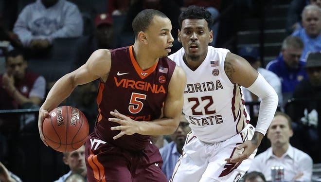 Virginia Tech Hokies guard Justin Robinson (5) works the ball around Florida State Seminoles guard Xavier Rathan-Mayes (22) during the second half during the ACC Conference Tournament at Barclays Center.