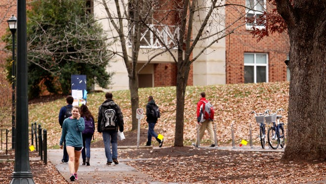 Students walk through the University of Virginia campus on December 6, 2014 in Charlottesville, Virginia.