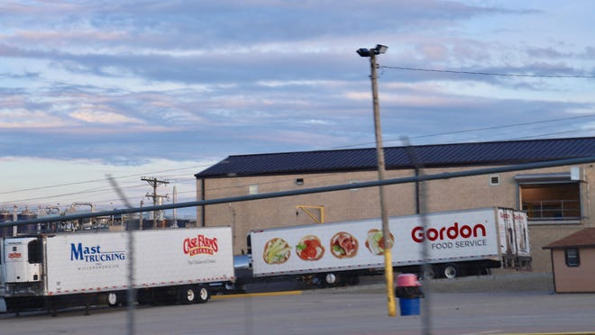 Refrigerated semitrailers are parked outside Case Farms' Winesburg plant, which some health officials wanted to close in the early hours of a coronavirus outbreak, but believed they did not have the authority to do so.