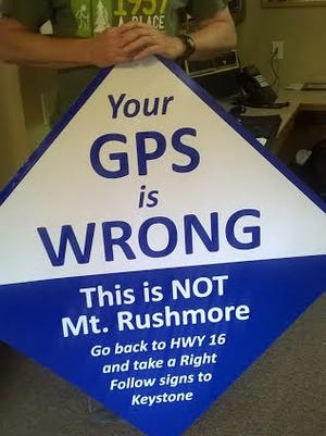 The Storm Mountain Center in the Black Hills has erected this sign to warn travellers that their GPS is sending them to the wrong location. As much as some visitors want to believe it, the camp is not Mount Rushmore.