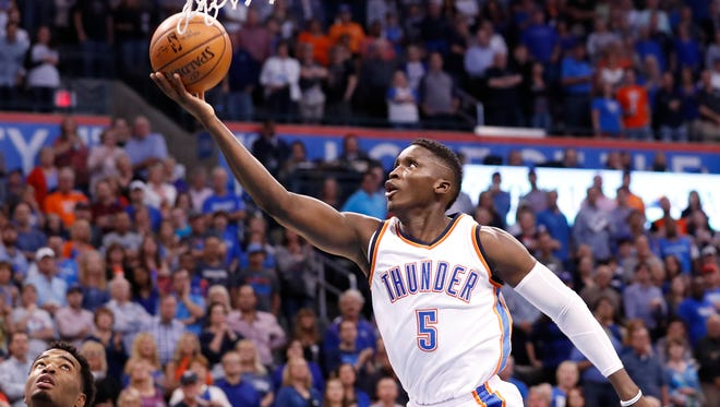 Victor Oladipo goes up for a layup during a game against the Phoenix Suns.