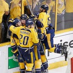Nashville Predators forward Viktor Arvidsson (38), of Sweden, celebrates with Ryan Johansen (92), Miikka Salomaki (20), of Finland, and Mike Ribeiro (63) after Arvidsson scored the winning goal in overtime to beat the San Jose Sharks in Game 6 of an NHL hockey Stanley Cup Western Conference semifinal playoff series Monday, May 9, 2016, in Nashville, Tenn. The Predators won in overtime 4-3 to tie the series 3-3. (AP Photo/Mark Humphrey)