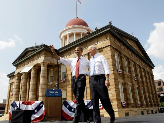 Barack Obama and Joe Biden greet crowds at a rally