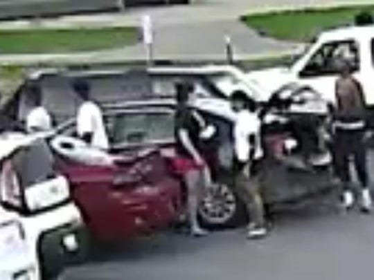 Another image released by LMPD's homicide unit. They said several people involved in a fatal shooting Sunday night fled the scene in this black passenger car.