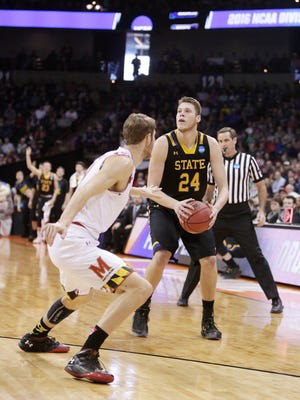 South Dakota State forward Mike Daum (24) posts up against Maryland forward Jake Layman during the first half of a first-round men's college basketball game in the NCAA Tournament in Spokane, Wash., Friday, March 18, 2016. (AP Photo/Young Kwak)