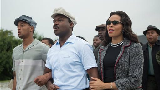"This photo released by Paramount Pictures shows, David Oyelowo, center, as Martin Luther King, Jr. and Carmen Ejogo, right, as Coretta Scott King in the film, ""Selma.""  (AP Photo/Paramount Pictures, Atsushi Nishijima)"