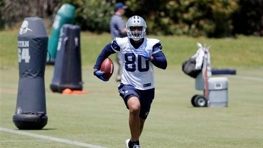 Dallas Cowboys tight end Rico Gathers carries the ball after catching a pass during drills during the team's NFL football minicamp, Friday May 6, 2016, in Irving, Texas.