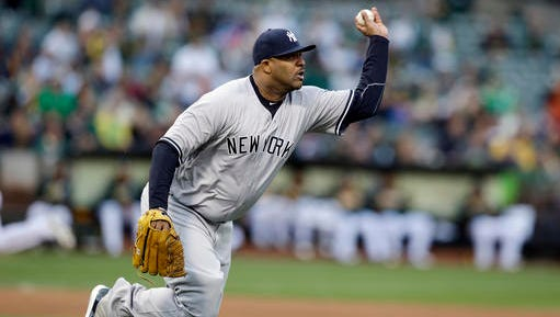 New York Yankees starting pitcher CC Sabathia throws out Oakland Athletics' Tyler Ladendorf at first base on a bunt attempt during the second inning of a baseball game Friday, May 20, 2016, in Oakland, Calif. (AP Photo/Marcio Jose Sanchez)