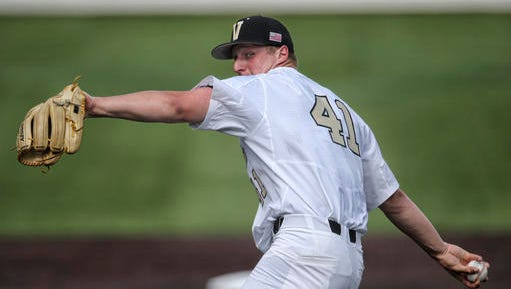 In this May 10, 2016 photo provided by Vanderbilt University, freshman pitcher Donny Everett throws against Louisville in an NCAA college baseball game in Nashville, Tenn. Officials report Everett drowned Thursday, June 2, while fishing in Tennessee. He was 19.