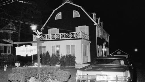 "FILE - In this Nov. 14, 1974 file photo, police and members of the Suffolk County Coroner's Office investigate the murder of six people found shot in Amityville, N.Y.  The Long Island home that served as the inspiration for the book ""The Amityville Horror"" and the subsequent films of the same name is being bought. Newsday reports, Friday, Nov. 18, 2016,  the infamous 1927 Dutch Colonial went into contract this week."