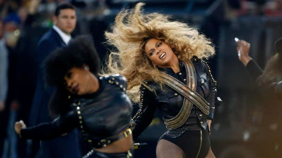"In this Sunday, Feb. 7, 2016, file photo, Beyonce performs during halftime of the NFL Super Bowl 50 football game in Santa Clara, Calif. Beyonce's ""Lemonade"" was one of 2016's best."
