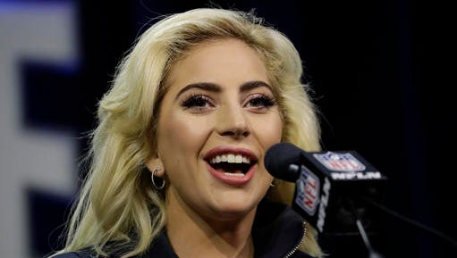 Lady Gaga answers questions at a news conference for the NFL Super Bowl 51 football game Thursday, Feb. 2, 2017, in Houston.