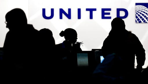 FILE - In this Saturday, Dec. 21, 2013, file photo, travelers check in at the United Airlines ticket counter at Terminal 1 in O'Hare International Airport in Chicago. After a man is dragged off a United Express flight on Sunday, April 9, 2017, United Airlines becomes the butt of jokes online and on late-night TV. Travel and public-relations experts say United has fumbled the situation from the start, but it's impossible to know if the damage is temporary or lasting. Air travelers are drawn to the cheapest price no matter the name on the plane.
