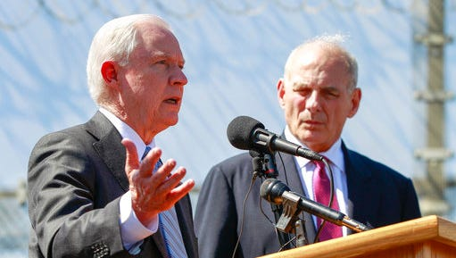 FILE - in this April 21, 2017, file photo, Attorney General Jeff Sessions, left, speaks as Secretary of Homeland Security John Kelly, right, listen during a news conference at the U.S.-Mexican border next to the Brown Field Border Patrol Station in San Diego.