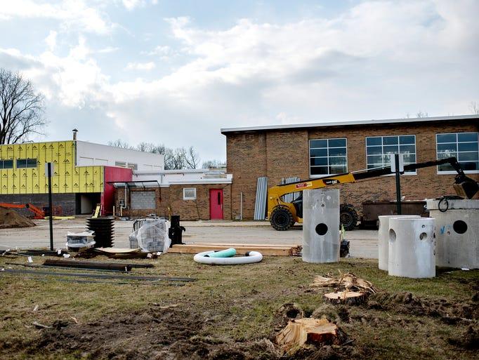 Red Cedar School ~ East lansing school officials break ground at red cedar