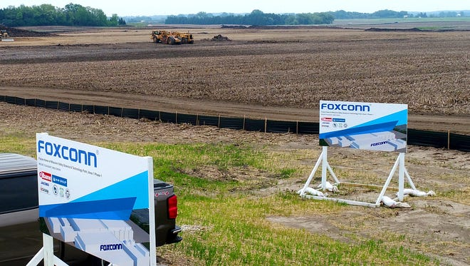 Foxconn signs are in place as work continues on the Foxconn facility south of Braun Road and west of Racine County Highway HH in Mount Pleasant.