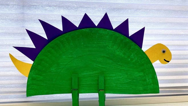 The Rochester Public Library Children's Room will now offer Take It and Make It Crafts kits for parents to pick up and do with their children. The first craft is a Paper Plate Dinosaur.